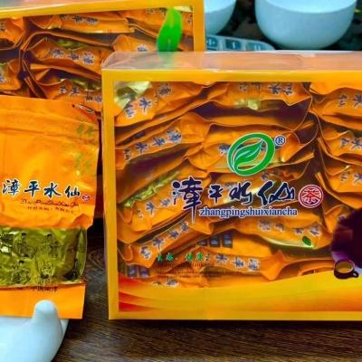 """漳平水仙茶属乌龙茶类又名""""纸包茶""""采用纯手工制作艺""""如兰似桂""""天然花香"""